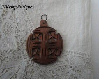 Religious wooden pendant