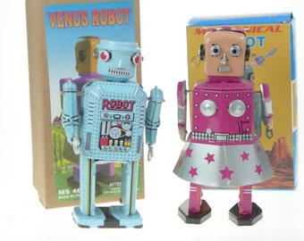 Space Themed Tin Toy  Clockwork Boy and Girl Robots