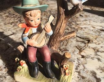 vintage cowboy figurine, hummel style cowboy with banjo, bisque figurine, banjo, western figurine, singing cowboy, vintage bisque figurine