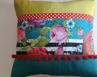 Square patchwork fabric and pom poms