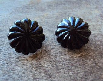 Retro black plastic clip on earrings with radiating sunburst pattern