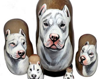 American Pit Bull Terrier on Five Russian Nesting Dolls. Dogs. White.