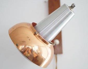 Brass- aluminum wall light.