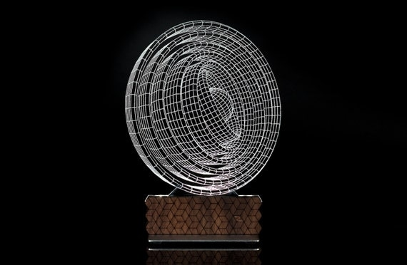 Ecliss 3D Illusion table lamp designed by Zinteh. Contemporary