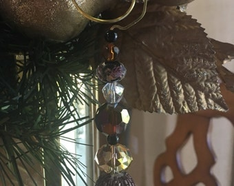 """5"""" handcrafted glass ornament on twisted brass wire"""