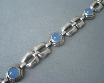 Classic silver bracelet with blue chalcedony stones by Kordes & Lichtenfels.