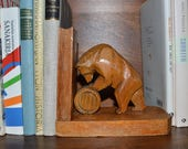Book end.A pair of bookends, hand-carved with  bear.