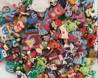 100 Pieces Variety Mystery Pack Characters Shoe Charms Party Favors Cupcake Toppers