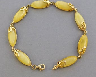 Genuine Baltic amber gold plated sterling silver bracelet .