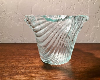 "Vase, made of clear  ribbed and draped fused glass, 3"" high, 2"" diameter base and 4"" wide at top."