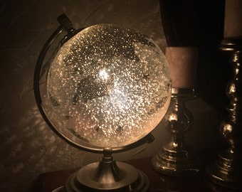 Globe light- mercury glass style globe with brushed silver base and meridian.  Night light
