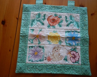 Wall Hanging with Spring Flowers and a Puppy Embroidered on a Turquoise & White Backing - Puppy - Embroidered Wall Hanging - Spring