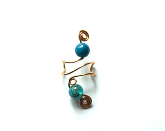 A spiral designed Blue Striped Agate gold ear cuff. Also available in 925 Sterling SIlver