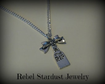 Earrings or necklace with a r.i.p. tombstone and a cute little bow