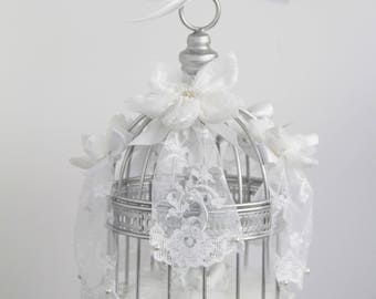 Wedding door alliances cage bird decorated with flowers lace and with Angel