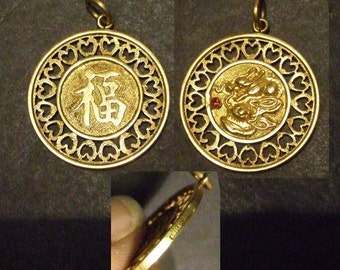 18k gold dragon pendant from Hong Kong in 1950's with ruby.  4.5 g, 27 x 2 mm.