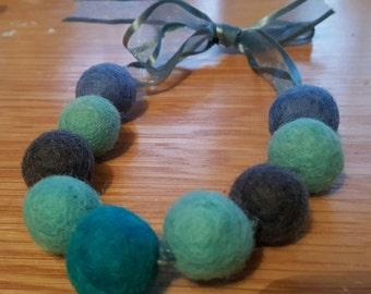 Felt wool ball necklace in Blues