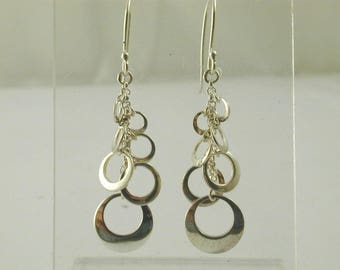 sterling silver 925 earrings hanging non-concentric circles. french hook. 3.2g