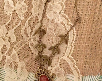 Bronze necklace with fire red sparkle pendant-reduced to clear