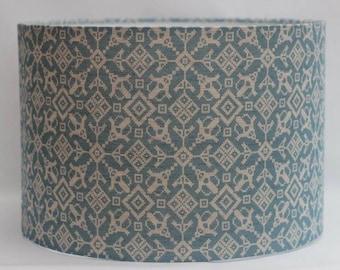 Handmade teal blue 'Balalaika' contemporary geometric tapestry print on natural 100% linen drum lampshade