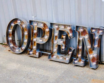 Open metal marquee bulb signs for business and storefronts comes with globe bulbs comes ready to hang on a single bracket.