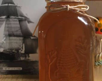 Our One Pound Embossed Bottle of Raw Honey