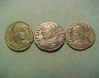 Three Roman Imperial bronze coins in very fine condition. (RM3)