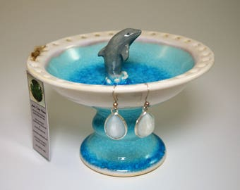 Hand thrown dolphin jewelry dish in beautiful crackled sea blue glaze on porcelain