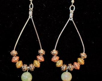 Elongated hoop earrings with beads.