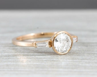 1 carat diamond solitaire engagement ring handmade in rose gold with baguette accent stones