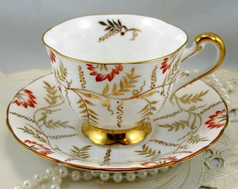 Elegant, delicate gold leaf pattern Teacup & Saucer made by Royal Chelsea, Fine Bone China in England.