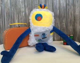 Hug Monster with ribbons, handmade plush , dark blue and yellow with skateboard pocket, friendly monster for child, unique gift, ready to go