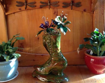Vintage boot with three hand painted metal sculpted flowers