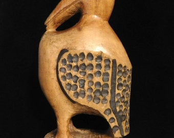 Folk art woodcarving of fat bird