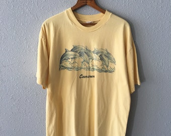 1990's Dolphin Graphic Vintage Cancun Mexico School of Dolphins Yellow T Shirt