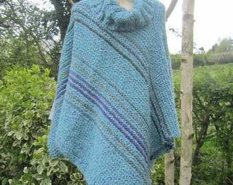 Blue poncho (Kelly2). Large, boxy women's poncho in very soft boucle yarn. Knitted. Purple and green stripes. Acrylic.