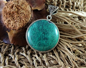 large round turquoise pendant set in 925 sterling silver