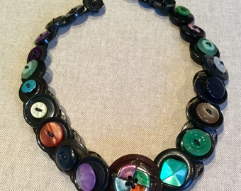 Button Necklace, double layered, on black leather thread, with loop to fasten at back.