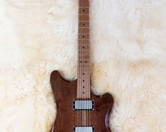 Custom electric solid-body guitar for left or right handed players