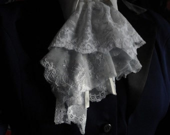 in clear blue and white lace jabot