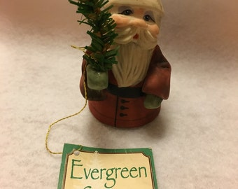 Adorable vintage Santa holding an Evergreen tree figurine