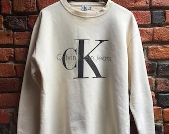 90s Calvin Klein Cream Beige Sweatshirt Sweater With C K Calvin Klein Jeans Logo Slogan Size Small Medium
