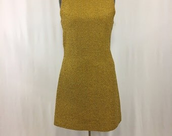 1960's Gold metallic sleeveless wiggle dress with large gold bow down the back of dress!