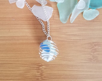 Silver tone cage pendant filled with beach glass