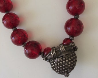 Cherry Amber beaded necklace with Tibetan Relic centre.