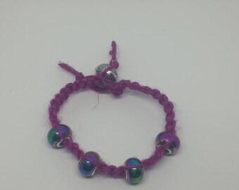 Pink Jute woven bracelet with aurora borealis beads