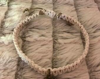 White hemp braided bracelet with gold heart charm