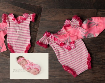 Floral and striped pink newborn romper with matching headband.