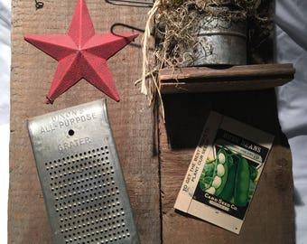 Vintage primitive barn wood plaque with antiques and flower arrangemwnt