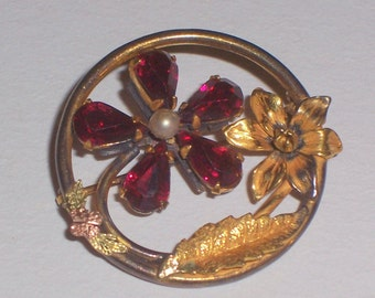Vintage Brooch with Red Rhinestones and a Pearl Center